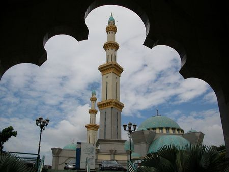 Mosque framed by an islamic arch