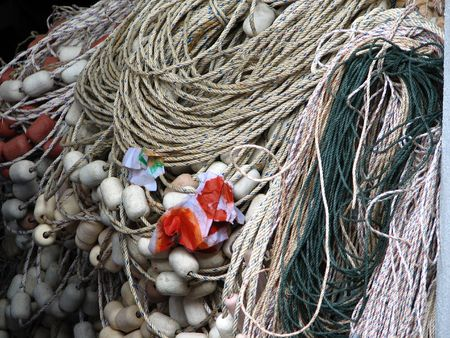 Fisherman boat ropes and buoy