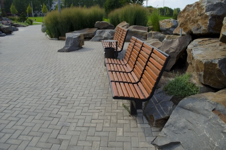 Two benches and big stones in park photo