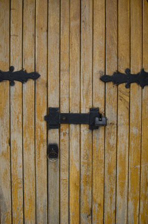 New interesting old door with iron shutters photo