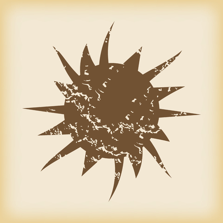 proclaim: Grungy brown icon with image of starburst, on beige background