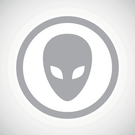 alien face: Grey image of alien face in circle, on white gradient background