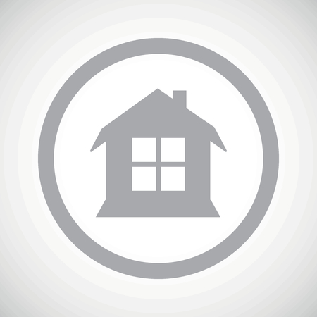 housetop: Grey image of house with window in circle, on white gradient background