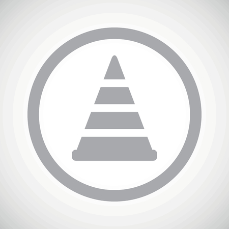 Grey image of traffic cone in circle, on white gradient background