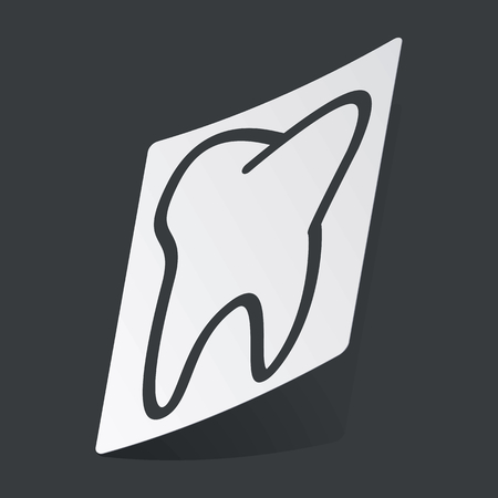 dens: White sticker with black image of tooth, on black background