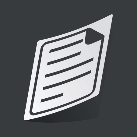 article writing: White sticker with black image of document page, on black background