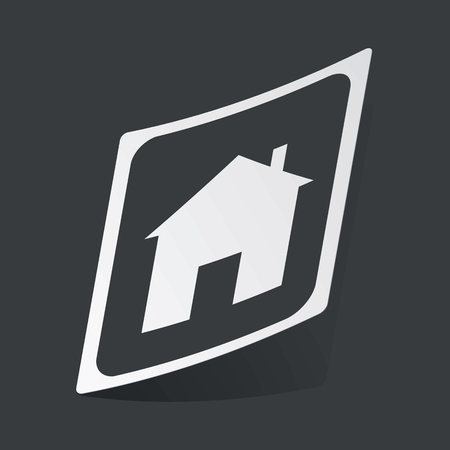 housetop: White sticker with black plate with house image, on black background