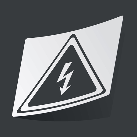 high voltage sign: White sticker with black image of high voltage sign, on black background