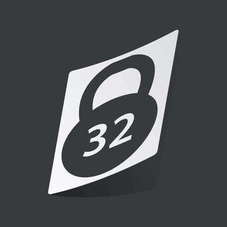 32: White sticker with black image of 32 kg dumbbell, on black background