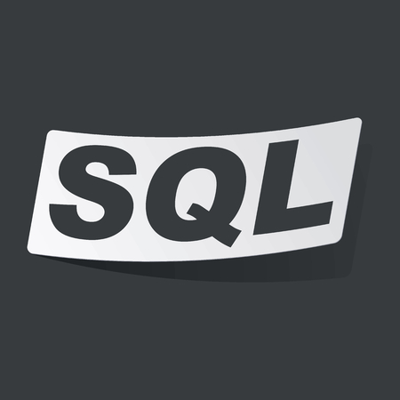 sql: White sticker with black text SQL, on black background