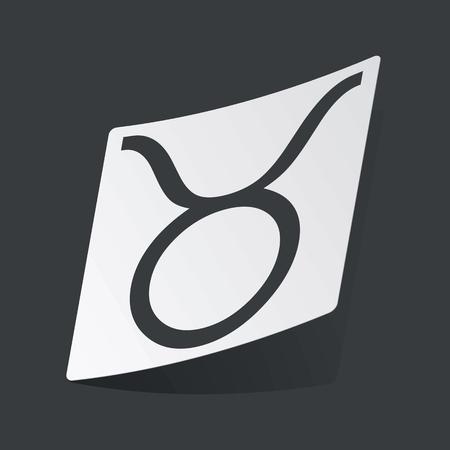 ecliptic: White sticker with black image of Taurus zodiac symbol, on black background