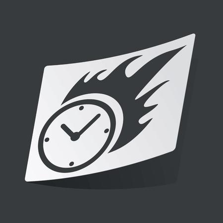bounds: White sticker with black image of burning clock, on black background