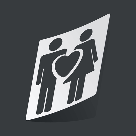 black woman: White sticker with black image of man, woman and heart, on black background