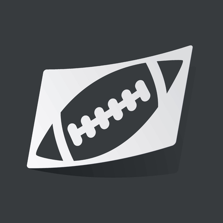 gridiron: White sticker with black image of rugby ball, on black background
