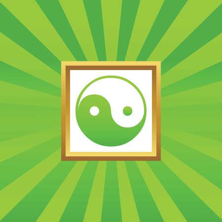 Image of ying yang symbol in golden frame, on green abstract background