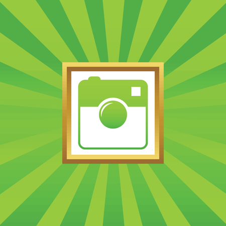 microblog: Image of square camera in golden frame, on green abstract background