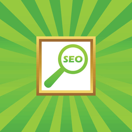 nuance: Text SEO under loupe in golden frame, on green abstract background