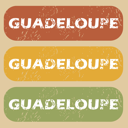 guadeloupe: Set of rubber stamps with country name Guadeloupe on colored background