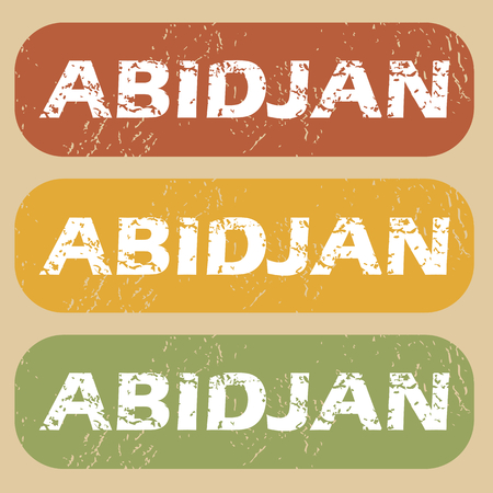 cote d ivoire: Set of rubber stamps with city name Abidjan on colored background