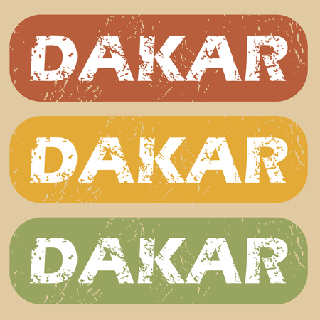 dakar: Set of rubber stamps with city name Dakar on colored background