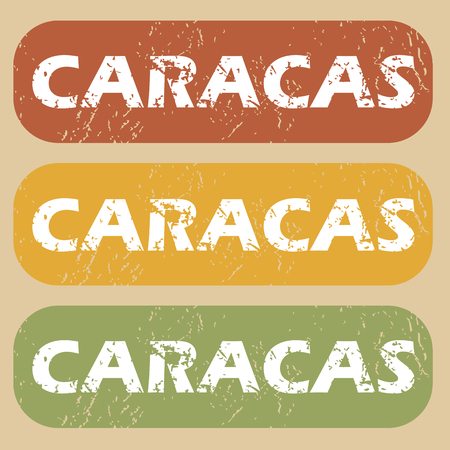 caracas: Set of rubber stamps with city name Caracas on colored background