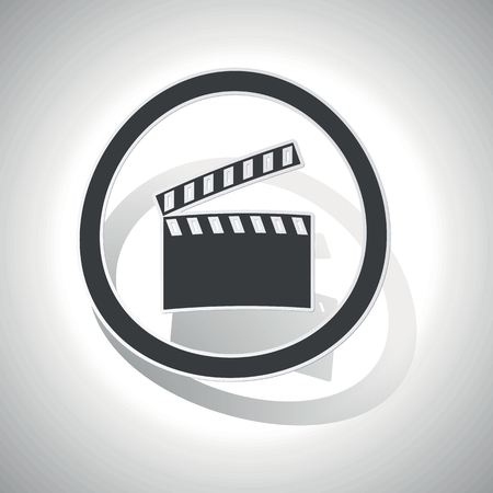 cinematograph: Curved circle with image of clapperboard and shadow, on white Vectores