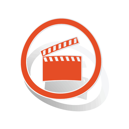 cinematograph: Clapperboard sign sticker, orange circle with image inside, on white background