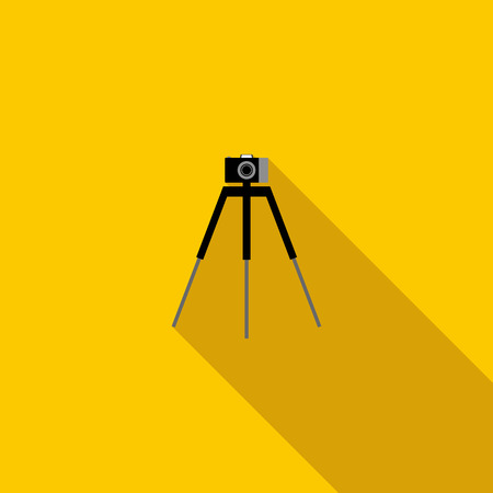 tripod: Camera on a tripod icon in flat style on a yellow background