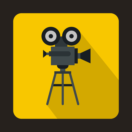 tripod projector: Old movie camera with reel icon in flat style on a yellow background