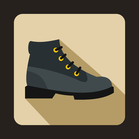 Gray boot icon in flat style on a beige background