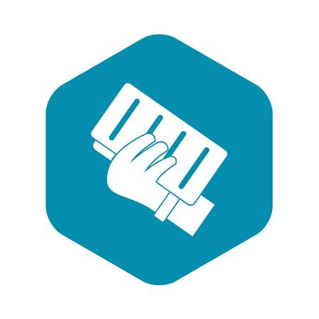 Brick in a hand icon. Simple illustration of brick in a hand vector icon for web