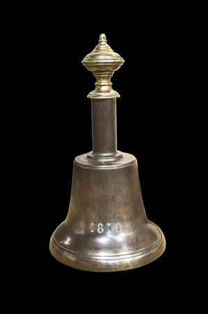 verdigris: A vintage copper bell on black background