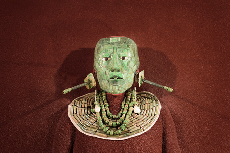 Jade mosaic funeral mask and the jewelry found in the tomb of Mayan king Pakal from Palenque, now in the National Museum of Anthropology, Mexico City
