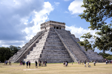 TINÚM, YUCATÁN, MEXICO - DEC 22, 2016:  The Temple of Kukulkan Pyramid (El Castillo Maya Pyramid) in Chichen Itza ruins, one of the Seven Wonders of the World and UNESCO World Heritage Site