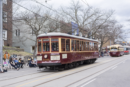 the vintage TTC streetcars driven along the Beaches Queen Street in the Easter Parade Editorial