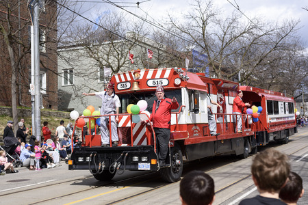 members of Rameses Shriners on float at the Beaches Easter Parade 2017 on Queen Street East Toronto.