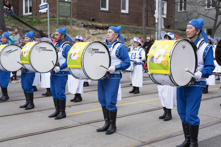 Falun Dafa marching band at the Beaches Easter Parade 2017 on Queen Street East Toronto.