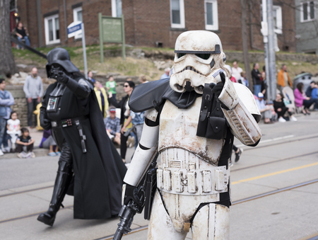the Star Wars characters Stormtrooper and Darth Vader walk along the Queen St E Toronto during the Beaches Easter Parade 2017