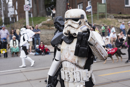the Star Wars character Stormtrooper walks along the Queen St E Toronto during the Beaches Easter Parade 2017