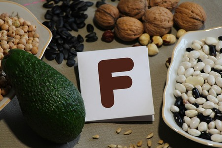 containing: Foods containing vitamin F : avocado, nuts, sunflower seeds, beans, chickpeas Stock Photo