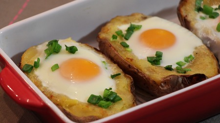 Twice baked potato. Potato baked with cheese, green onion and egg.