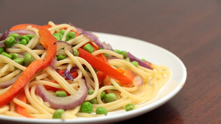 linguine pasta: linguine pasta with vegetables in white plate on wooden table
