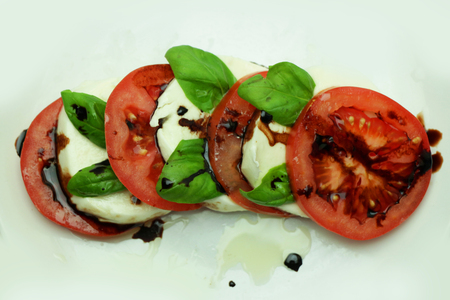 Caprese Salad on a White Plate with Balsamic Dressing
