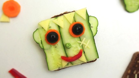 Open faced monster sandwich on a white plate. Healthy Halloween Treat