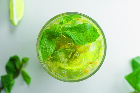 Homemade mojito cocktail with lime and mint in glass on a white backgroun Stock Photo