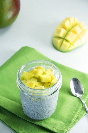 hia seeds pudding with mango in a glass jar. Healthy food Stock Photo