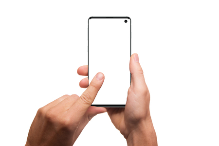 Hands holding smartphone with blank screen isolated on white background. Hand holding modern black phone in vertical position. Trendy phone mockup.