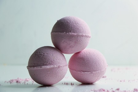 Natural homemade pink bombs for bath on white background. Natural cosmetics, SPA concept.