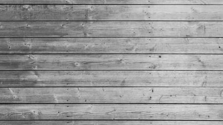 Struttura della parete di legno bianca o grigia con sfondo di motivi naturali. Contesto del piano d'appoggio in legno grigio. Archivio Fotografico
