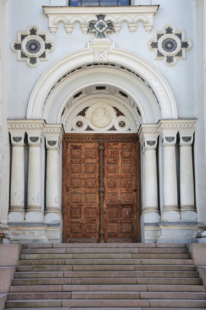 Entrance door of St. Michael the Archangels Church in Kaunas. Beautiful european church in Lithuania. Stock Photo